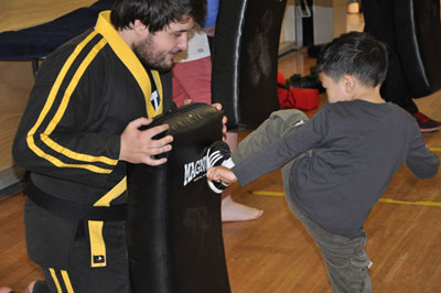 Nathan teaching children martial arts