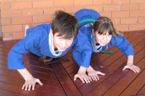 karate kids enjoy doing pushups
