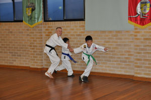 Kids having fun and making friends in a martial arts class