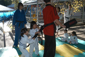 little children having fun in karate class