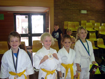 kids smiling in a martial arts class