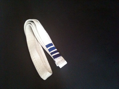 A white belt in Brazilian Jiu-Jitsu