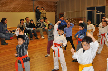 Supporting their children in a martial arts class